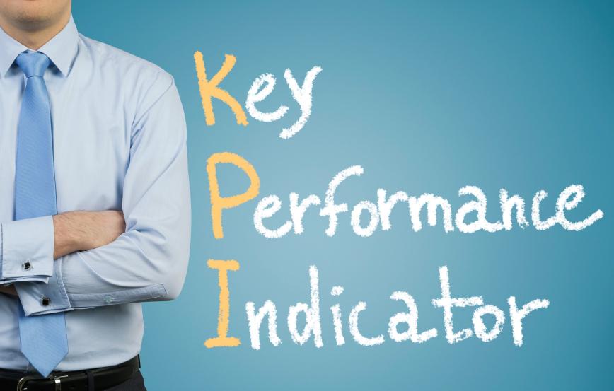 Businessman and drawing KPI symbol on dark background
