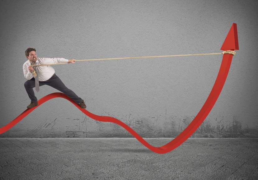 Determinated businessman with much effort lifts statistics