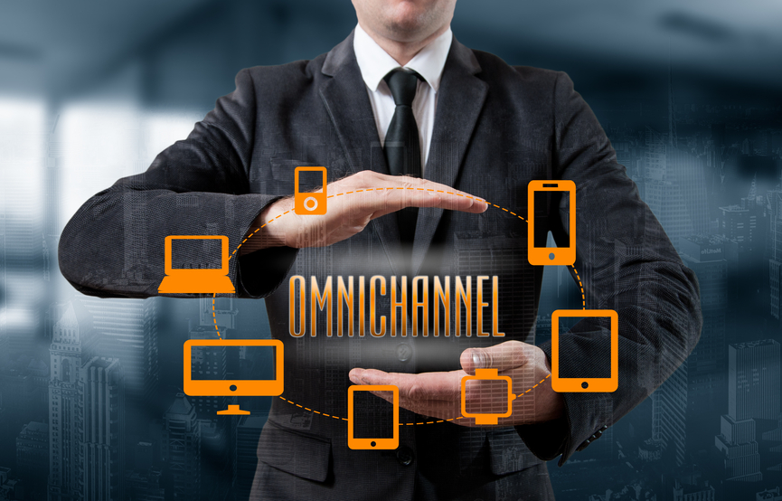 The concept of Omnichannel between devices to improve the performance of the company. Innovative solutions in business.The concept of Omnichannel between devices to improve the performance of the company. Innovative solutions in business.